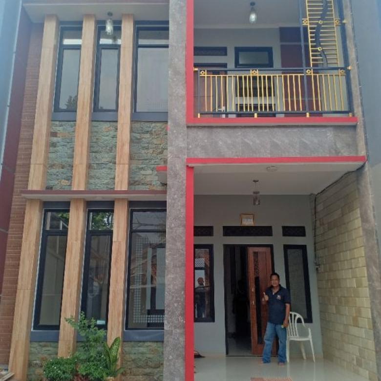 Rumah baru konsep 2 parkir mobil Cash KPR Jakarta timur
