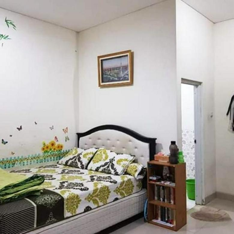 Rumah minimalis 2 lantai 4 kamar tidur di Griya Loka-B1