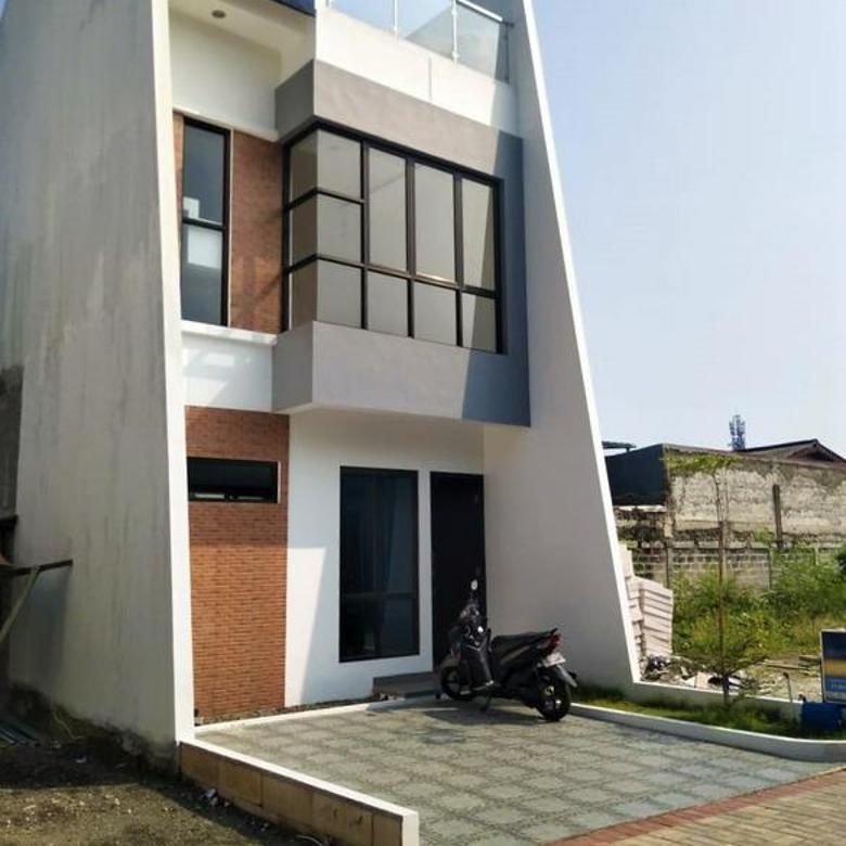 Perumahan 2,5 lantai plus rooftop harga ekonomis lokasi di beji timur