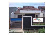 Rumah minimalis di metland,345