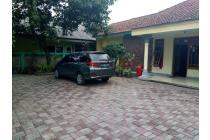 Dijual Sebidang tanah 1550 m2 + rumah tua dan kontrakan 8  pintu
