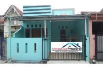 Rumah Biru Kokoh di Sektor V Grand Pondok Ungu Permai