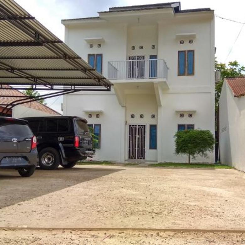 Rumah Minimalis dgn Halaman Parkir 8 Mobil Lokasi Mayang Jambi